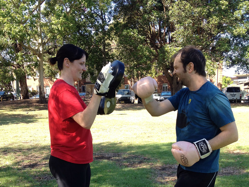 Couple boxing at Marrickville park