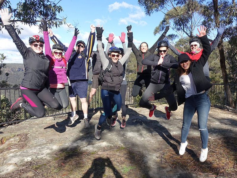 Group of people having fun jumping in Bundanoon